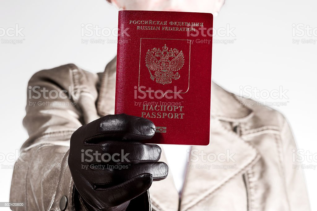 Woman giving set of documents to the viewer stock photo