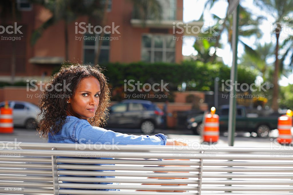 Woman glancing over shoulder stock photo