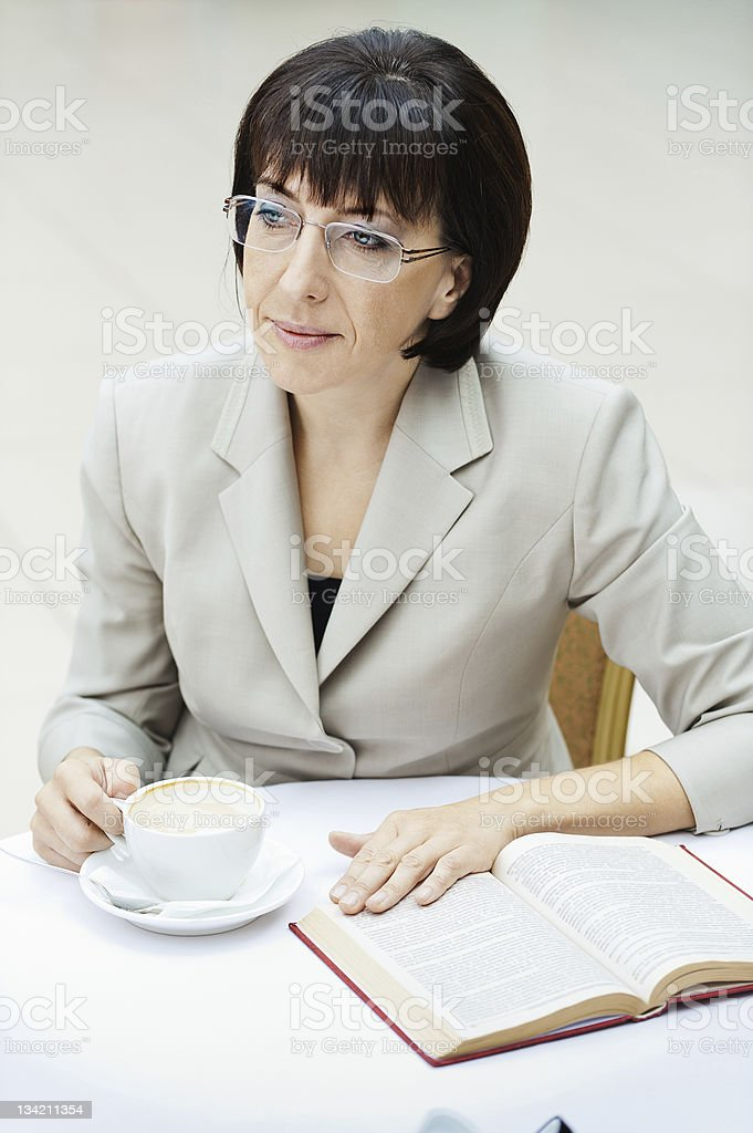 woman glasses cup book royalty-free stock photo
