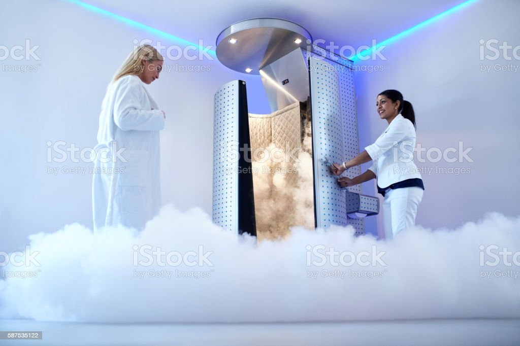 Woman going for cryotherapy treatment stock photo