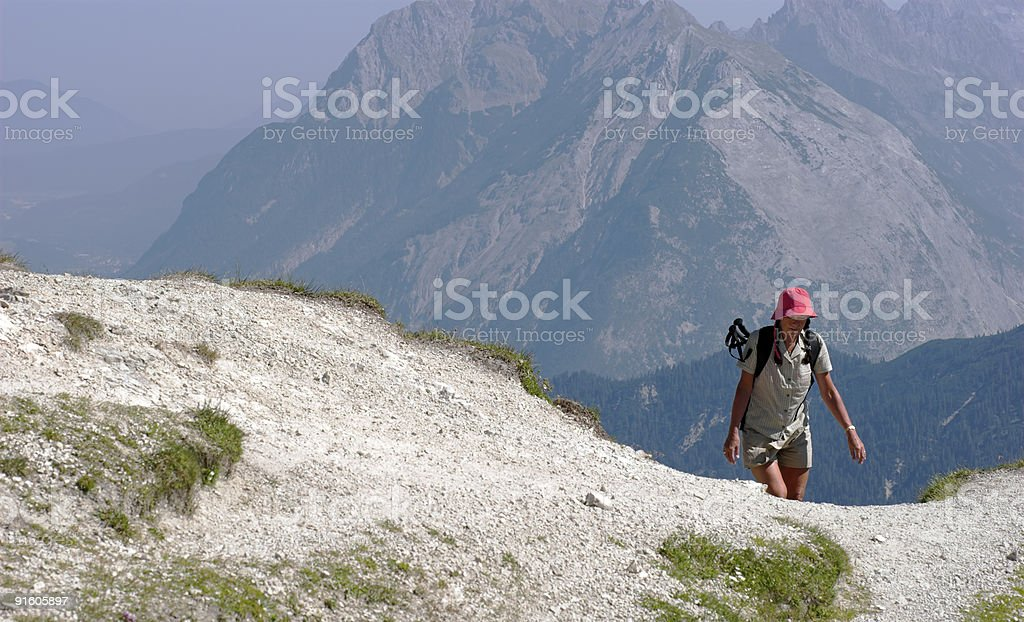 Woman going high-up in the alps royalty-free stock photo