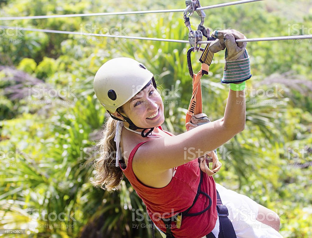 Woman going on a jungle zipline adventure stock photo