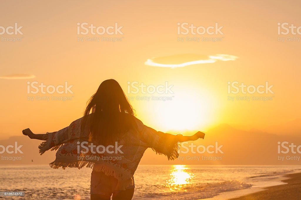 Woman going to susnet stock photo