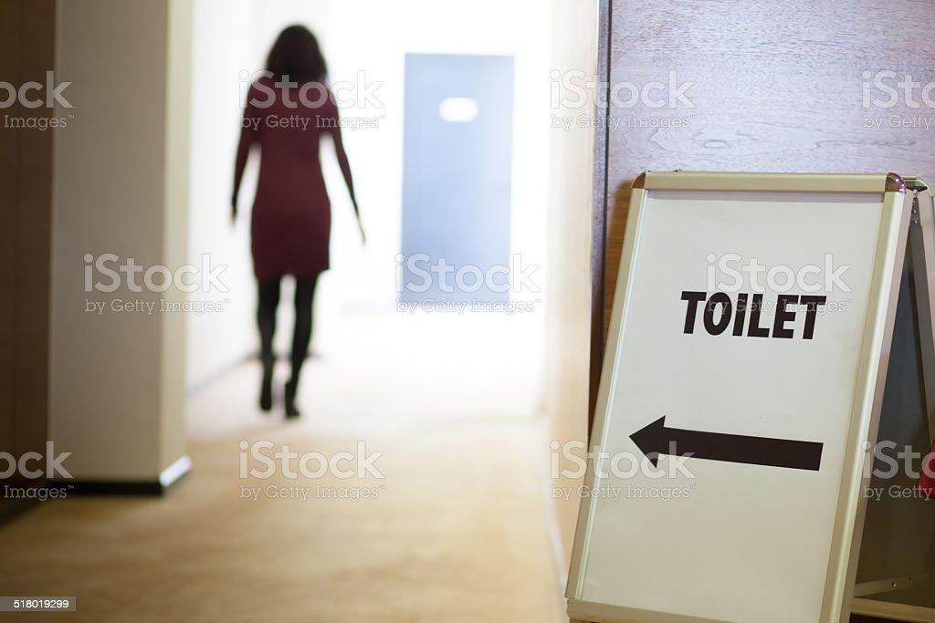 woman going to toilet stock photo