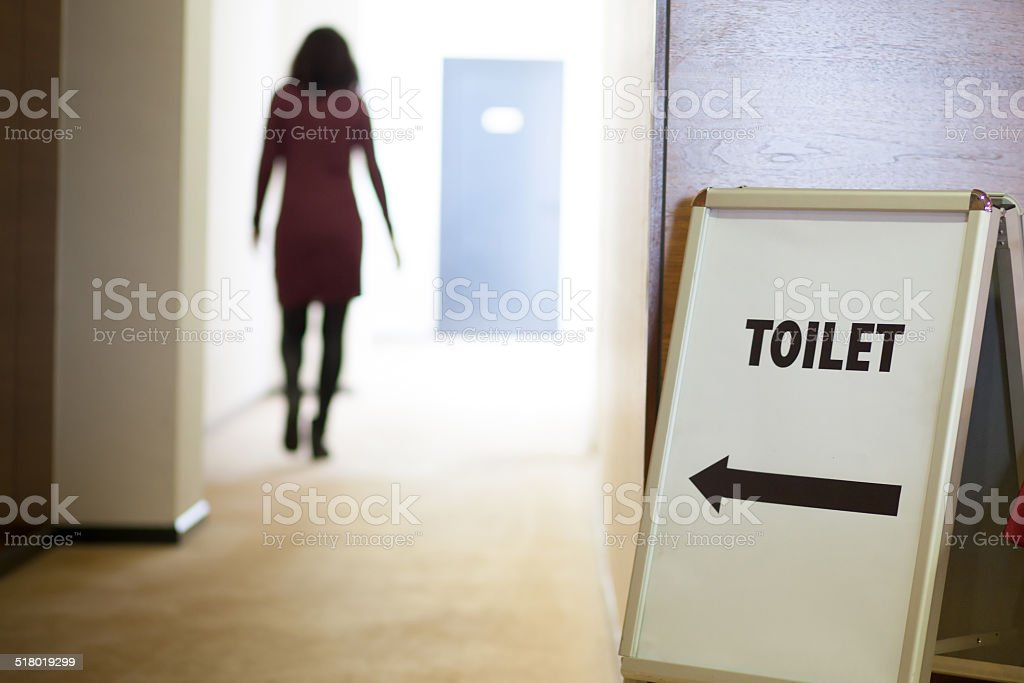 woman going to toilet stock photo