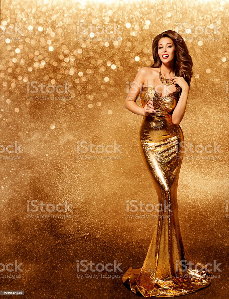 Woman Gold Dress, Fashion Model with Champagne Long Golden Gown stock photo