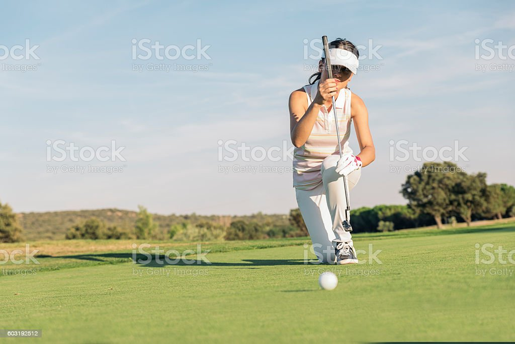 Woman golf player concentrating. stock photo