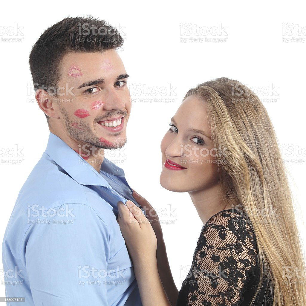 Woman grabbing man with many lipstick shapes stock photo
