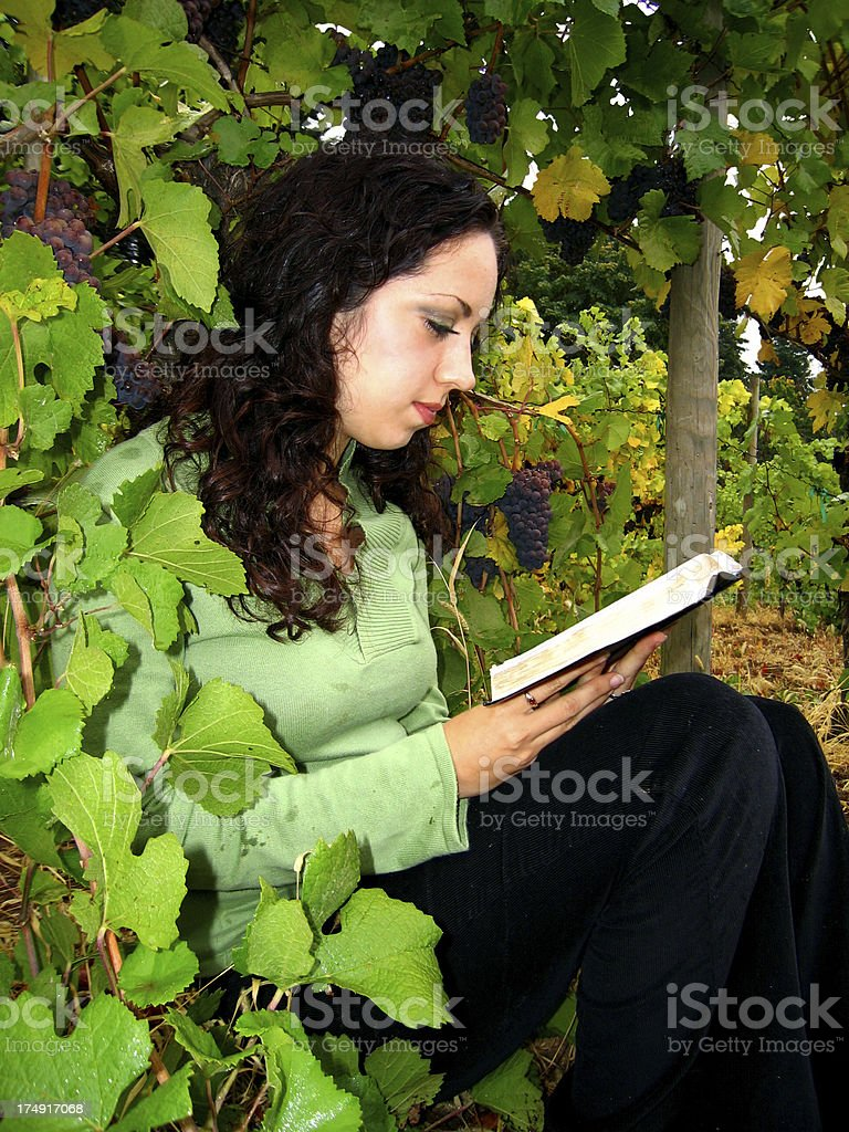 Woman Grapes and a Book stock photo