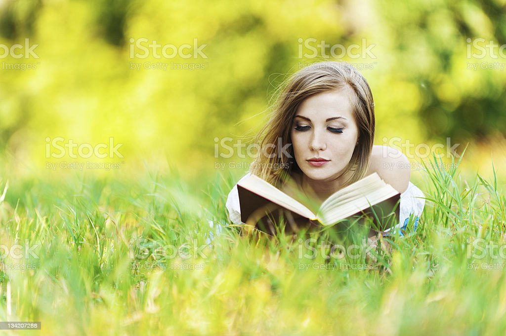 woman grass reading book royalty-free stock photo