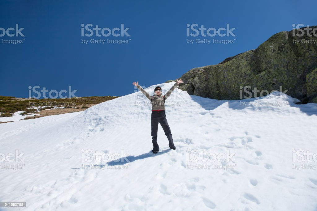 woman greeting from snow stock photo