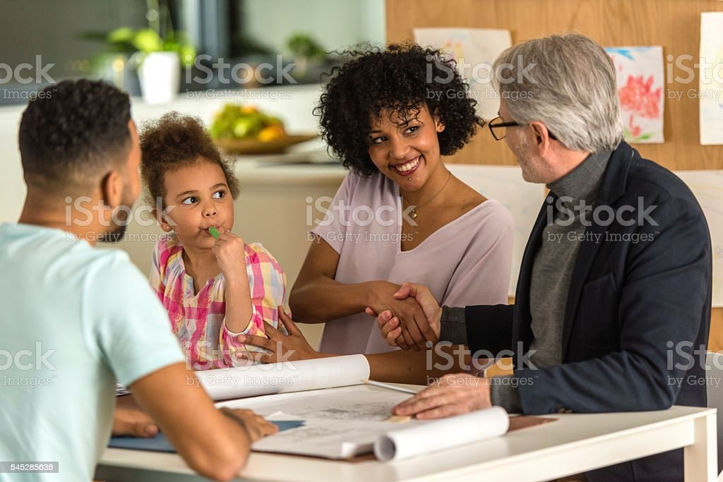 Woman greeting male financial advisor stock photo