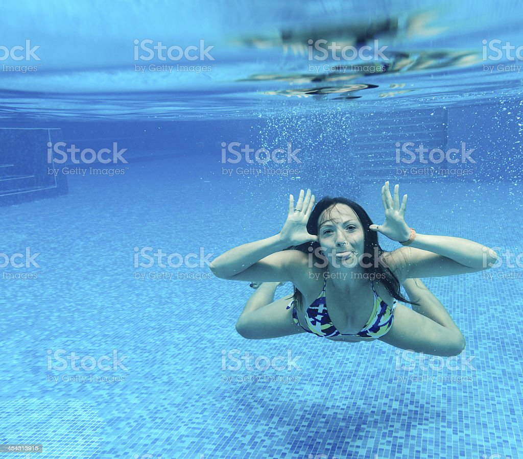 woman grimacing underwater royalty-free stock photo