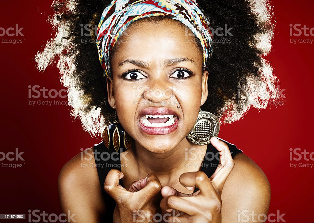 Woman grimacing with clenched fists has really lost her temper! royalty-free stock photo