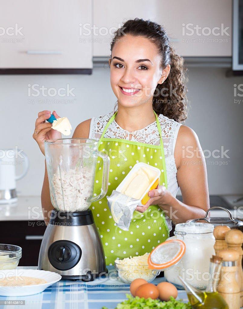 Woman grinding delicatessen ingredients stock photo