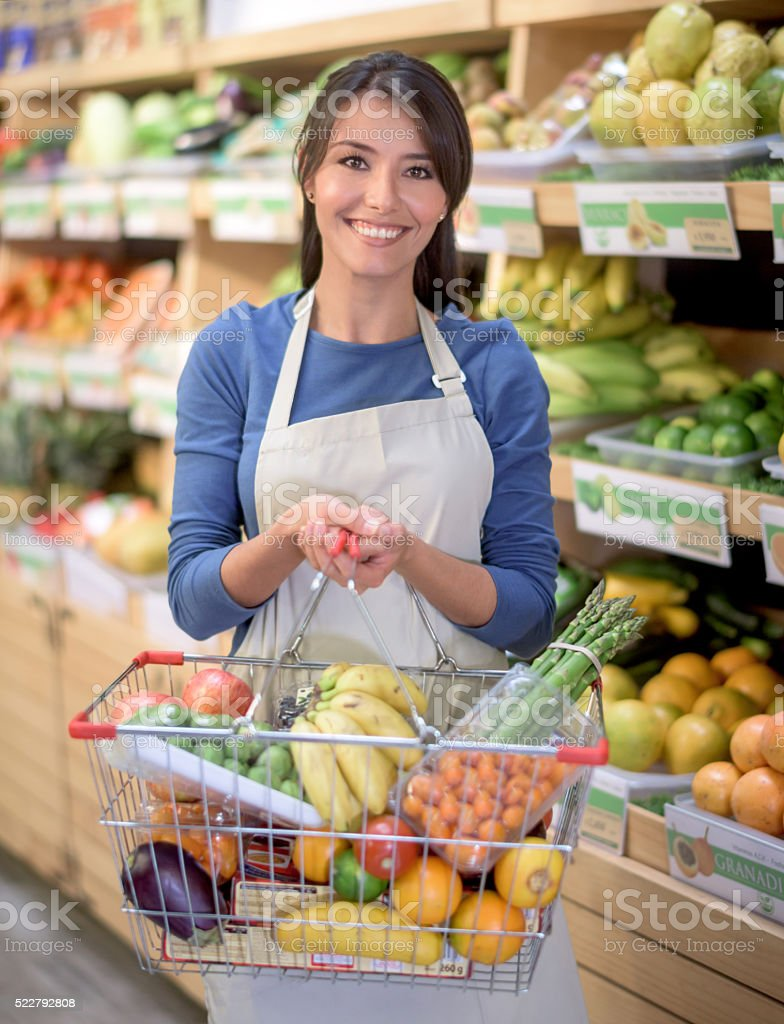 Woman grocery shopping at the supermarket stock photo