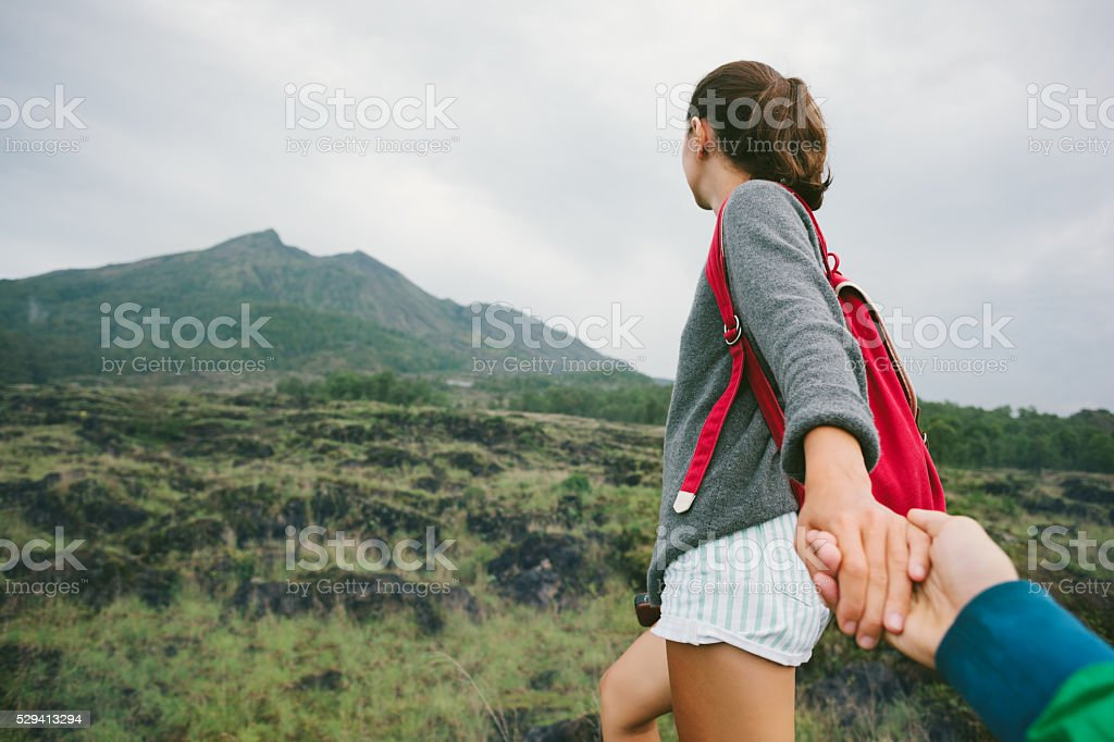 Woman guiding traveler into the wild stock photo