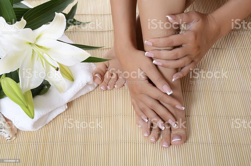 Woman hand and feet with manicure royalty-free stock photo