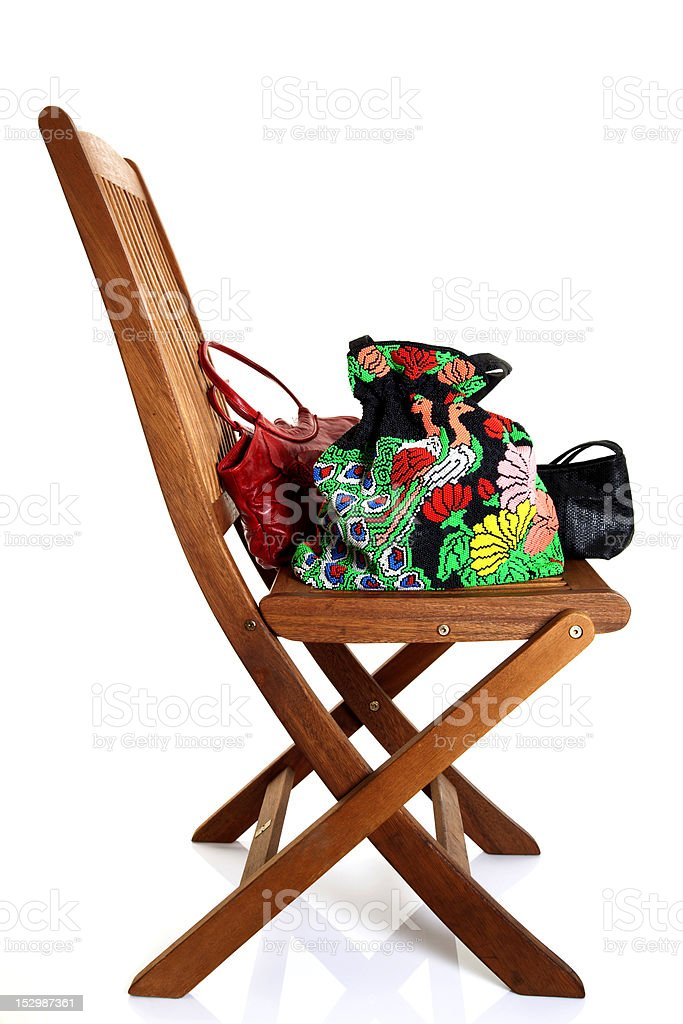 woman hand bags with wooden chair royalty-free stock photo