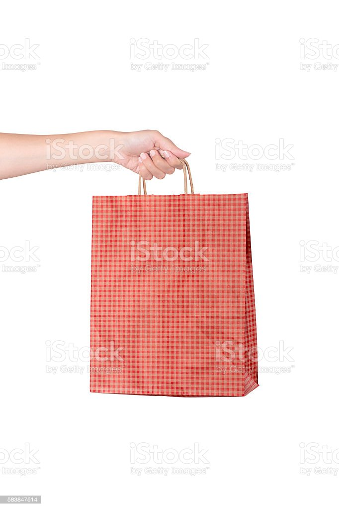 Woman hand carries a shopping bag isolated background stock photo