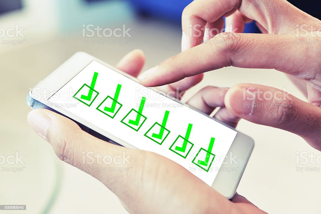woman hand check box on smart phone stock photo