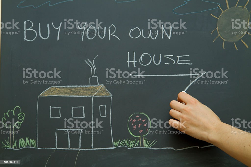 woman hand drawing on a chalkboard stock photo