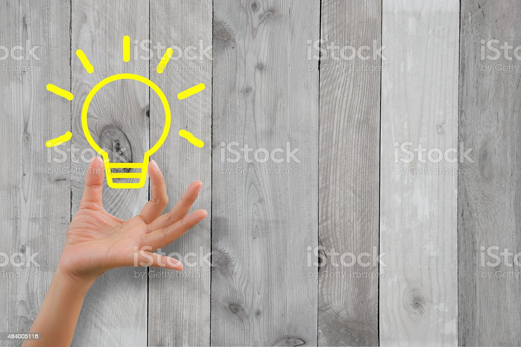 Woman hand handle idea with wooden background stock photo