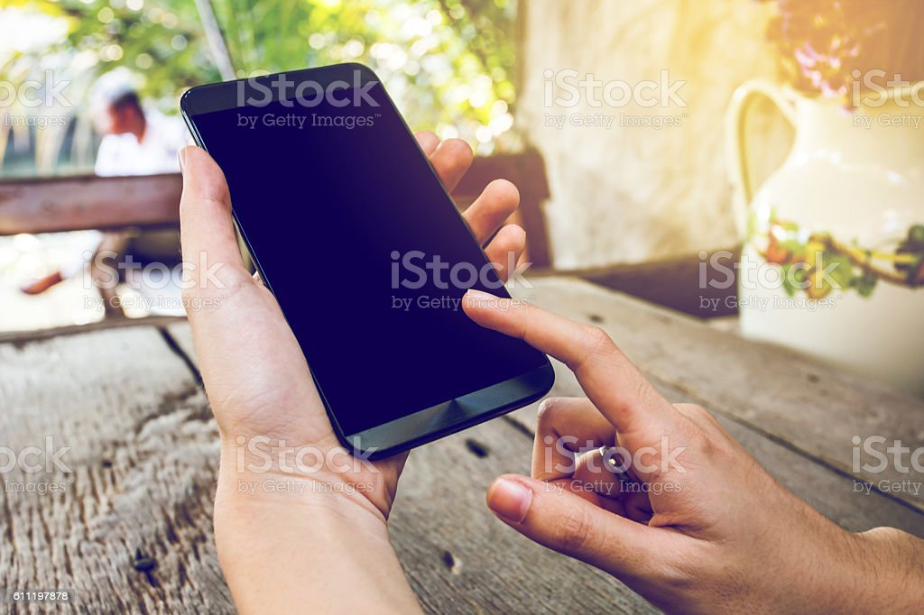 woman hand hold and touch screen smart phone stock photo