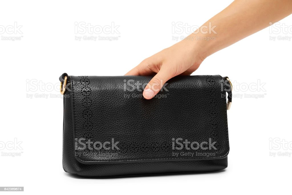 woman hand hold hand bag isolated on white background stock photo