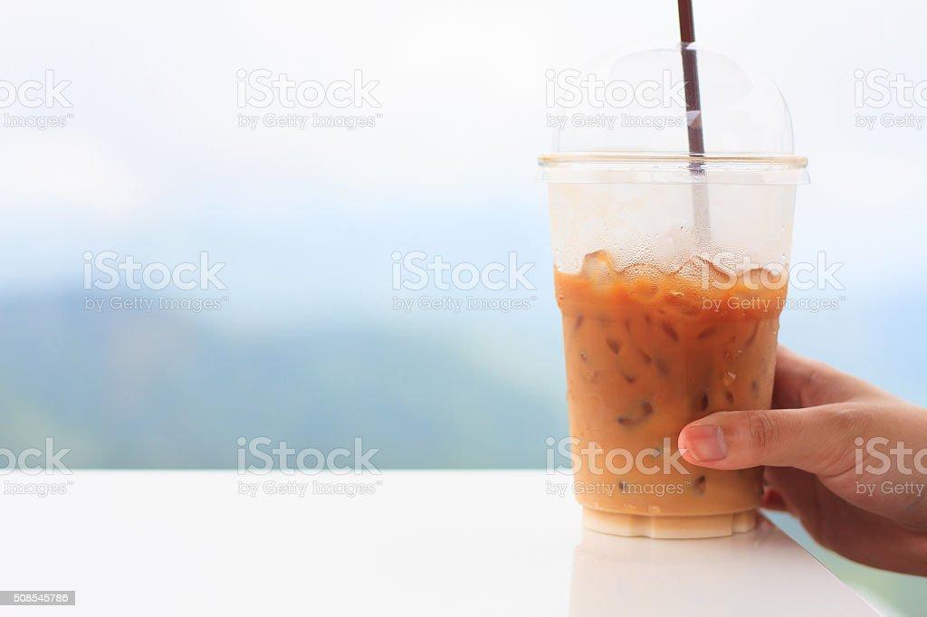 woman hand hold ice coffee cup stock photo
