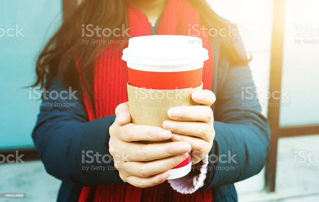 Woman hand holding a coffee in winter stock photo