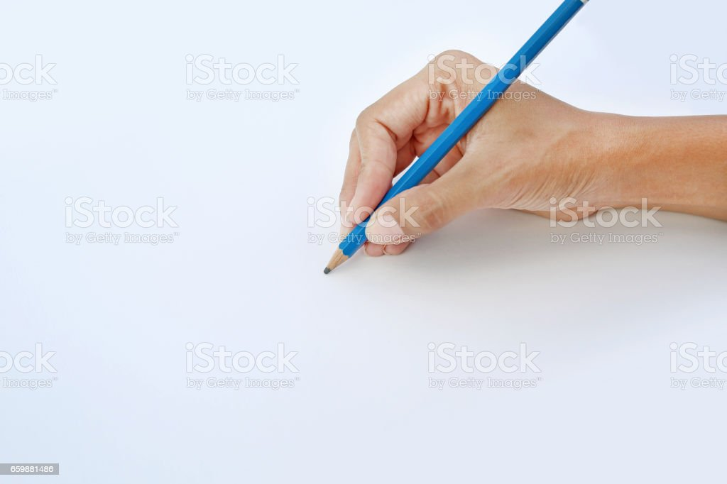 Woman hand holding a pencil. stock photo