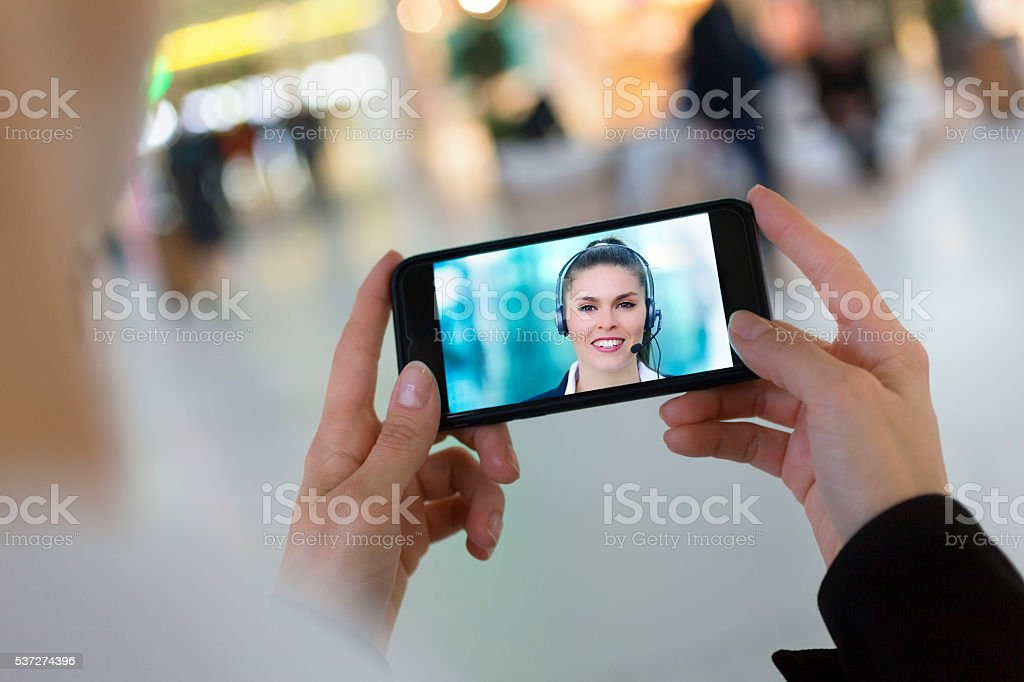 woman hand holding a smartphone during a skype video stock photo