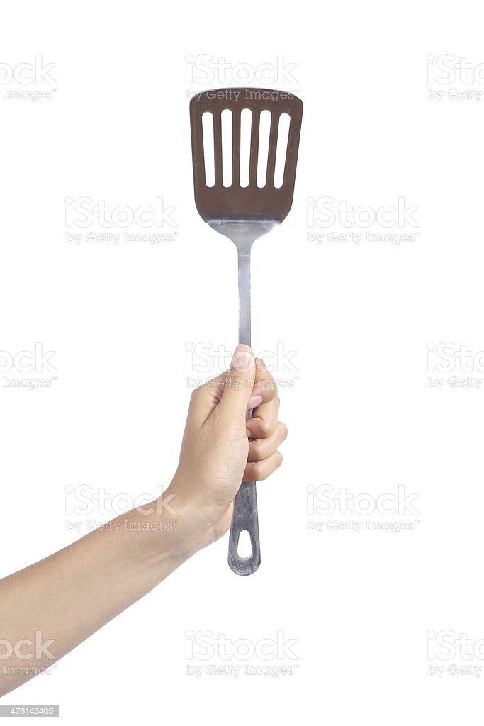 Woman hand holding a spatula stock photo