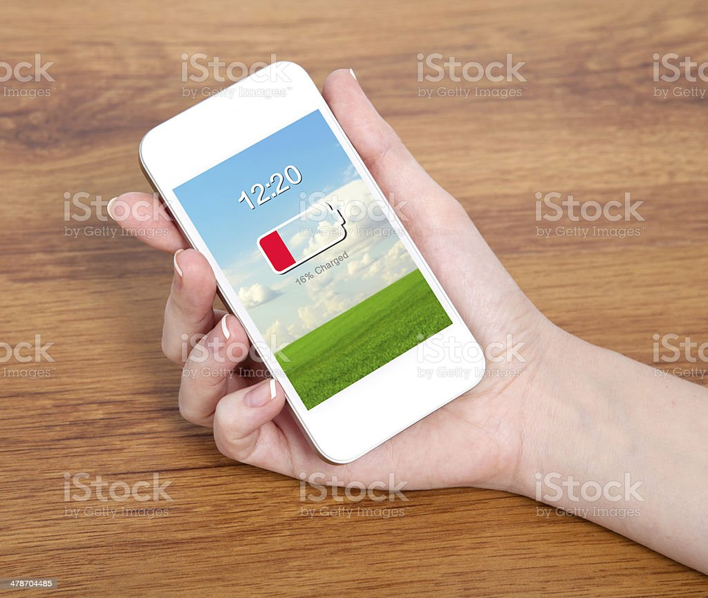 woman hand holding a touch white phone with low battery stock photo
