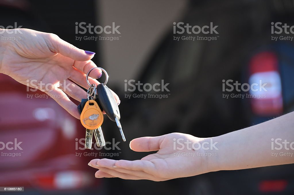 Woman hand holding  car key stock photo