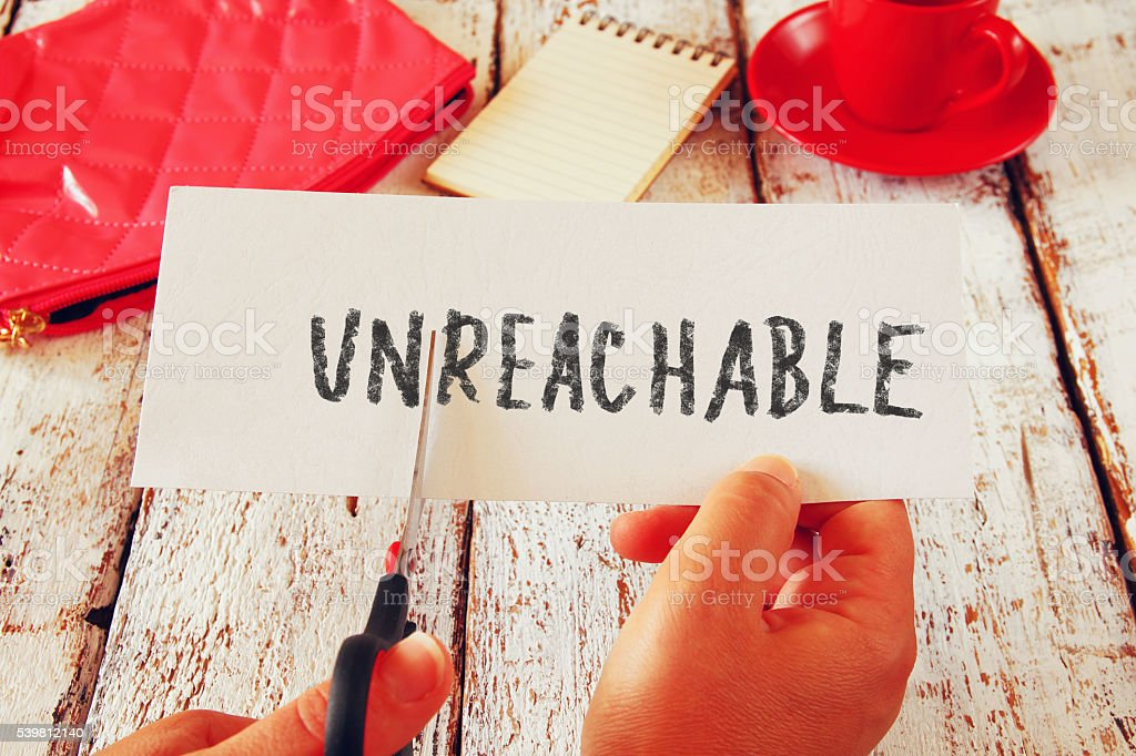 woman hand holding card with the text unreachable stock photo