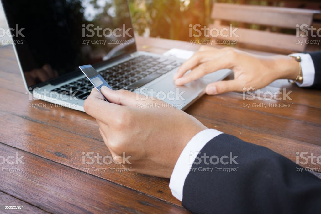 Woman hand holding credit card paid online. stock photo