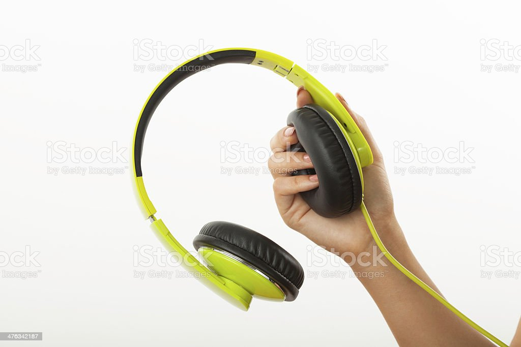 woman hand holding headphone on white royalty-free stock photo