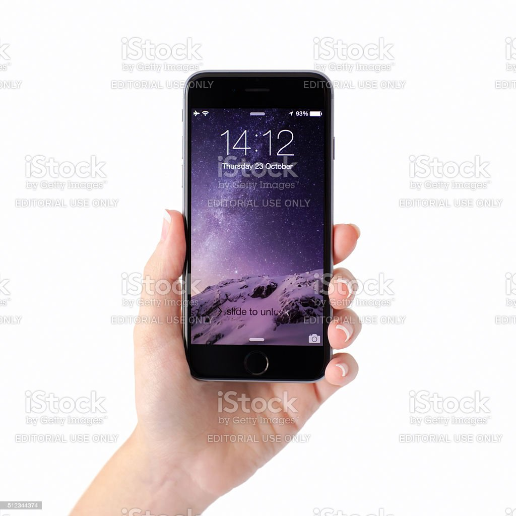 Woman hand holding iPhone 6 with unlock on the screen stock photo