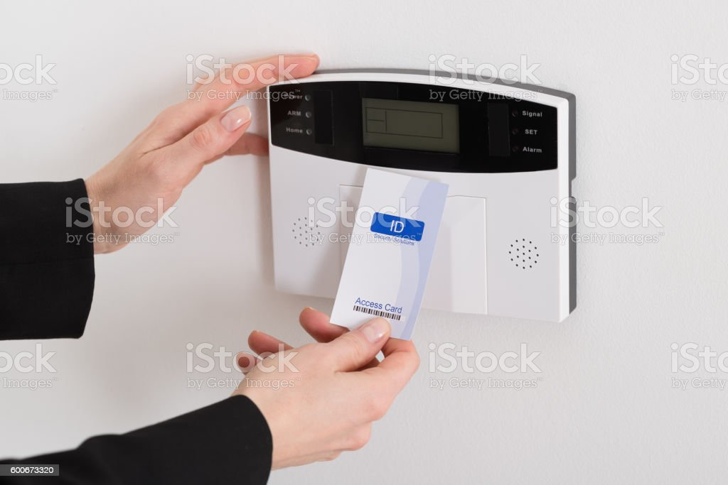 Woman Hand Holding Keycard To Open Door stock photo