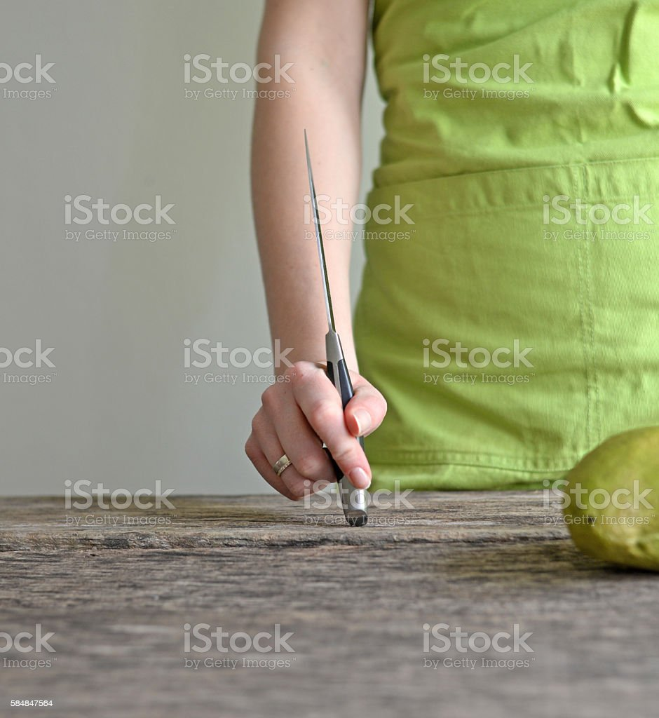 Woman hand holding knife stock photo
