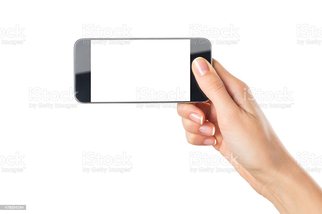 Woman hand holding mobile phone stock photo