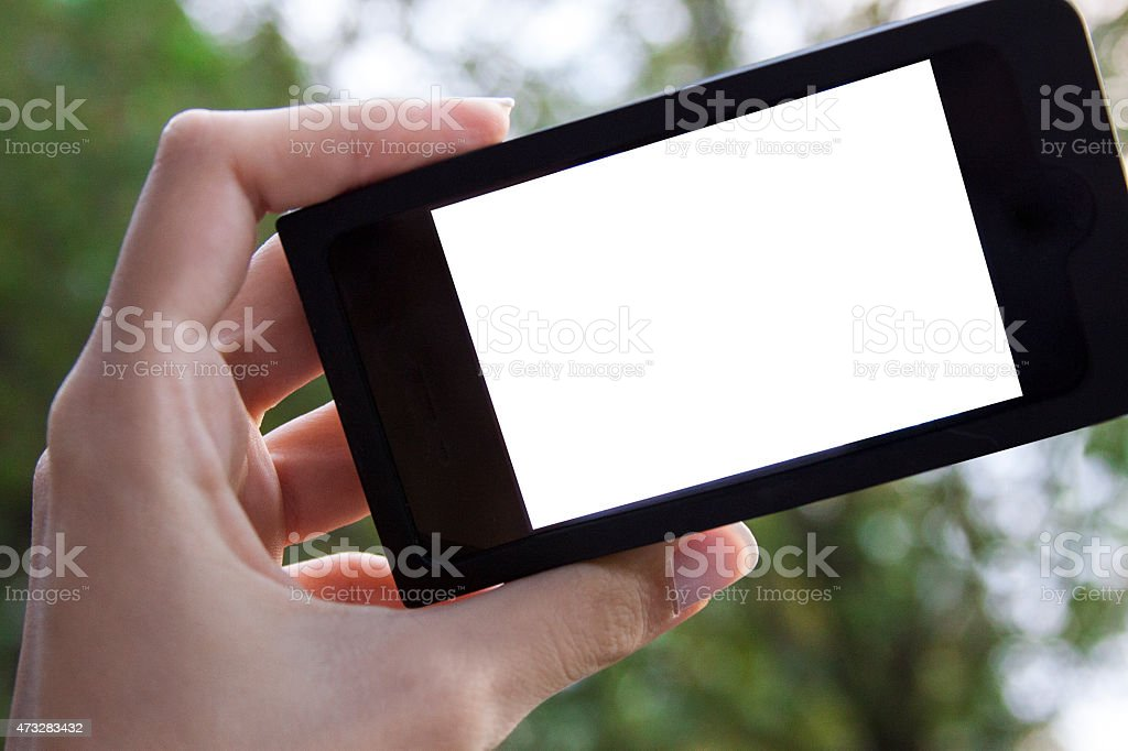 woman hand holding mobile smart phone outdoor stock photo