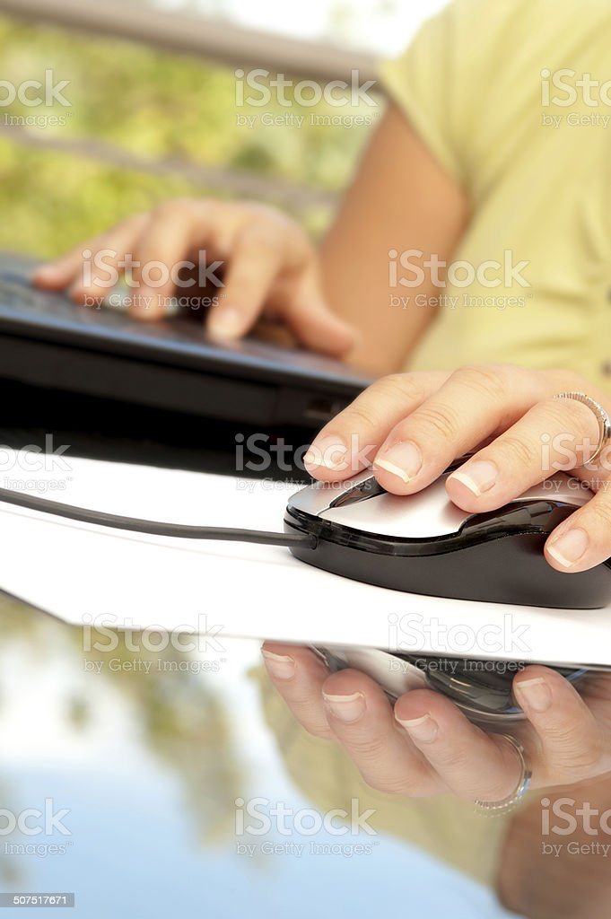 Woman hand holding mouse stock photo