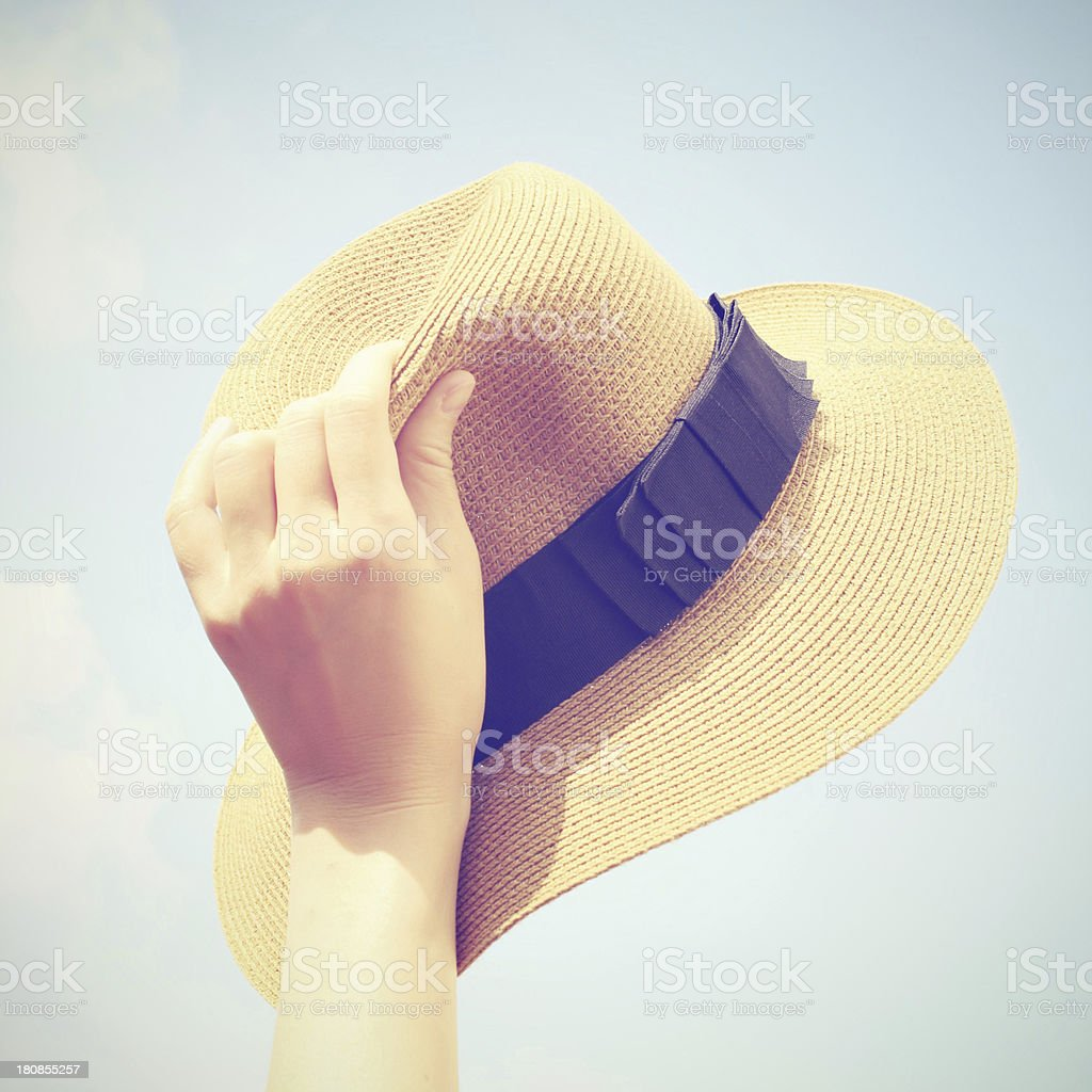 Woman hand holding panama hat with retro filter effect royalty-free stock photo