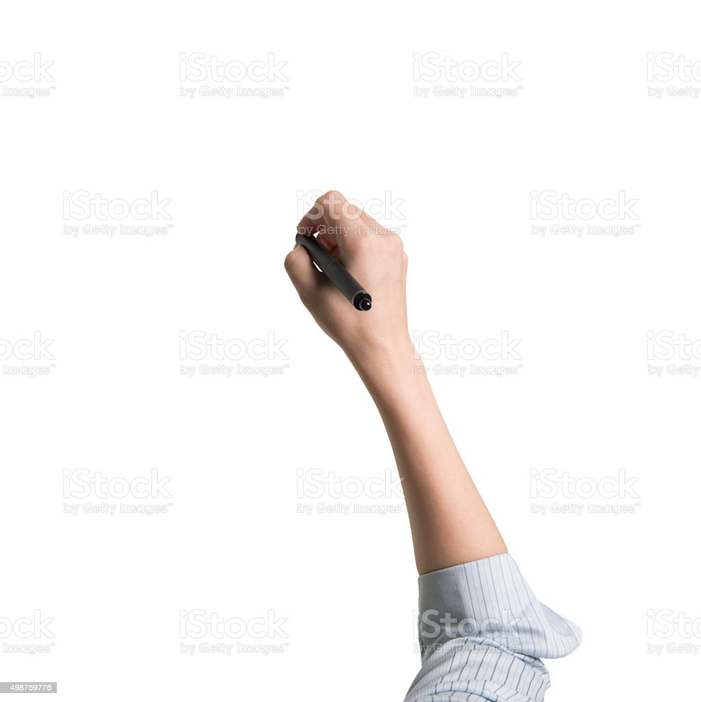 Woman hand holding pen writing front view stock photo