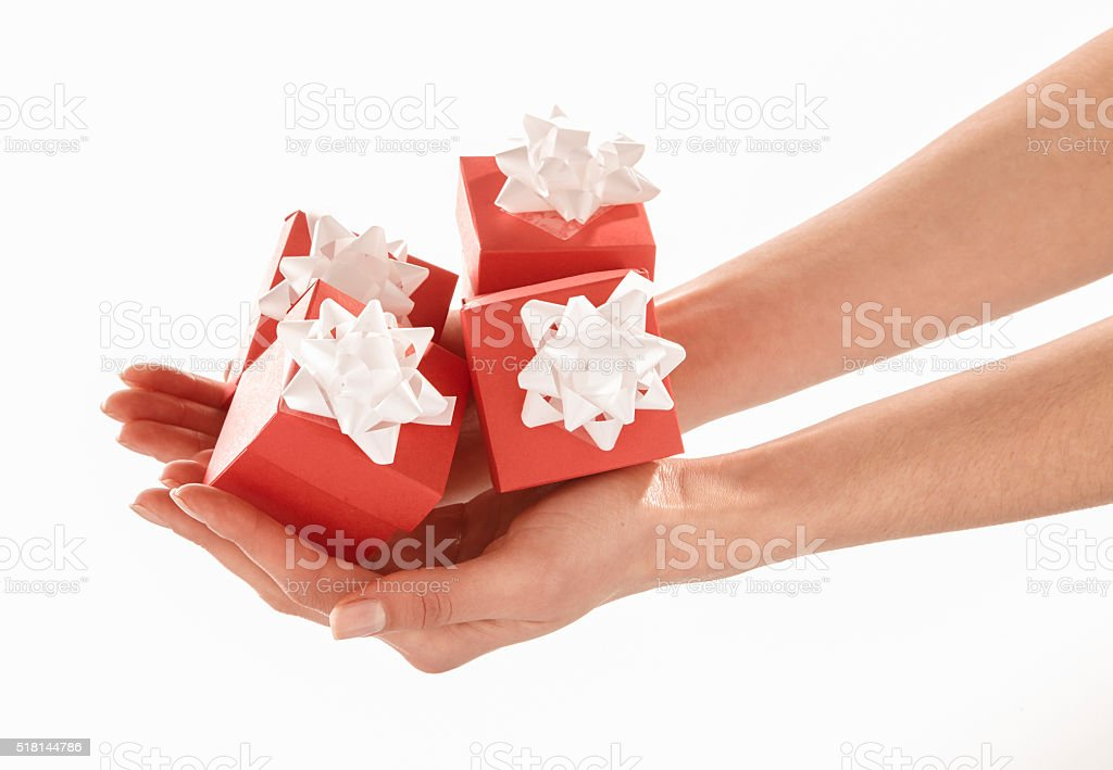 Woman hand holding red gift boxes stock photo