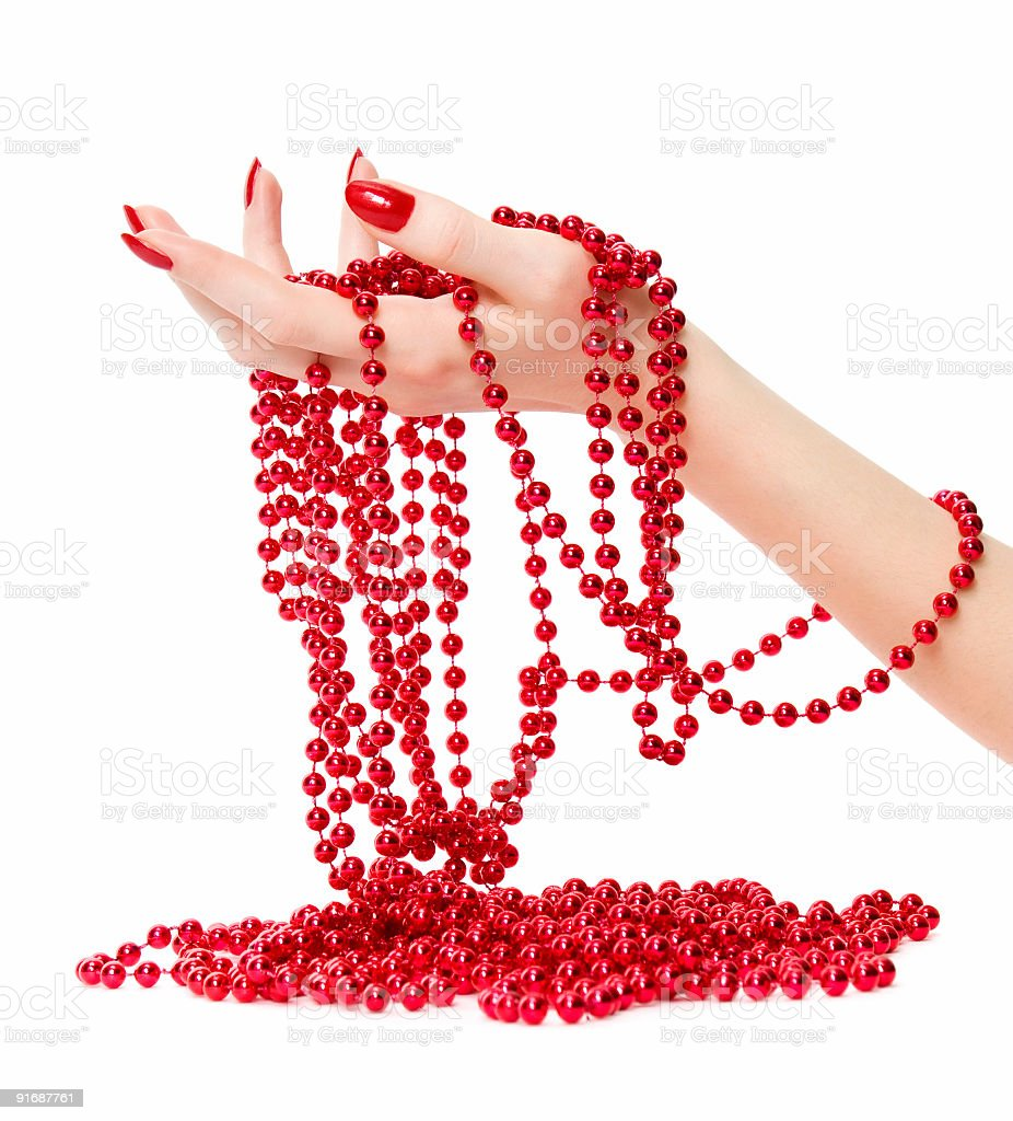 Woman hand holding red glassbeads royalty-free stock photo