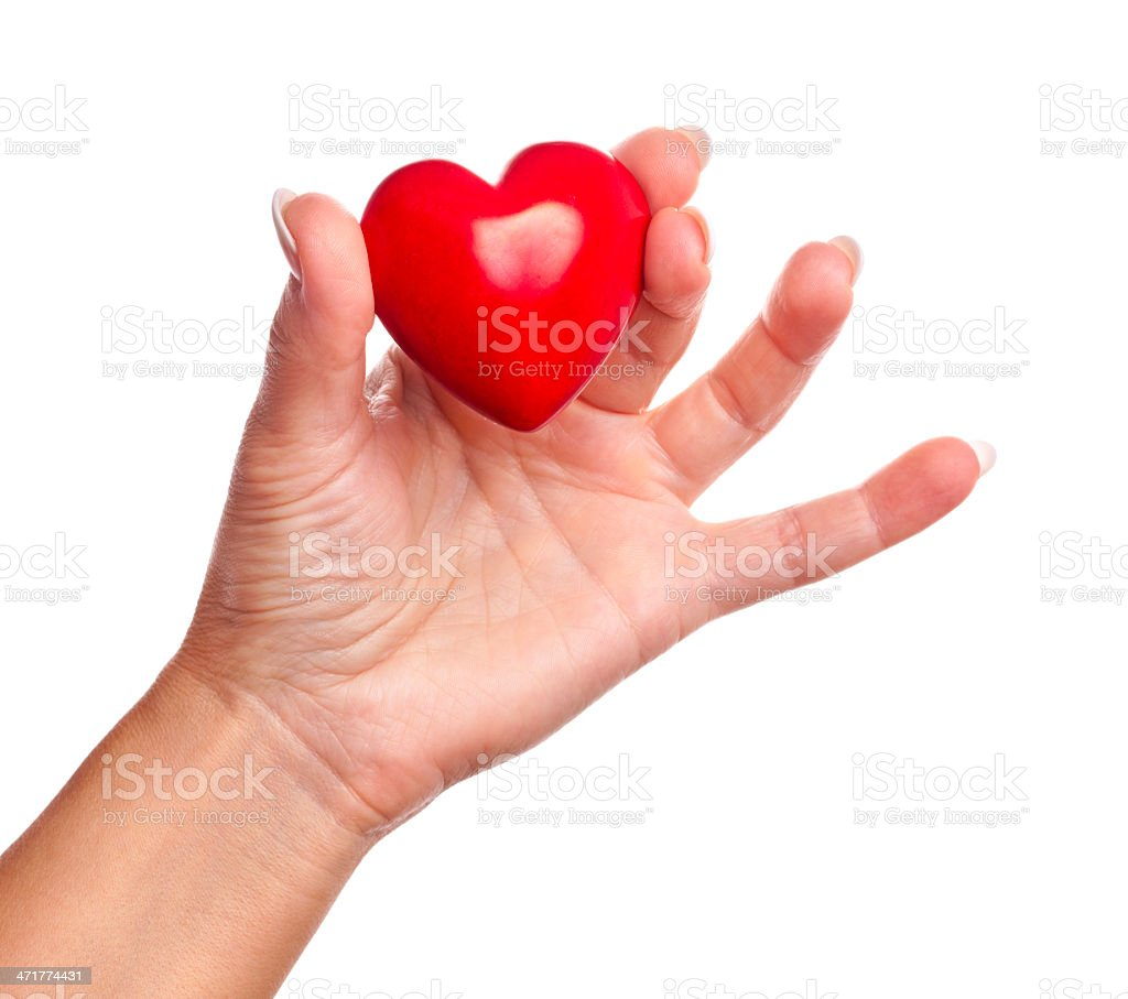Woman hand holding red heart on white stock photo